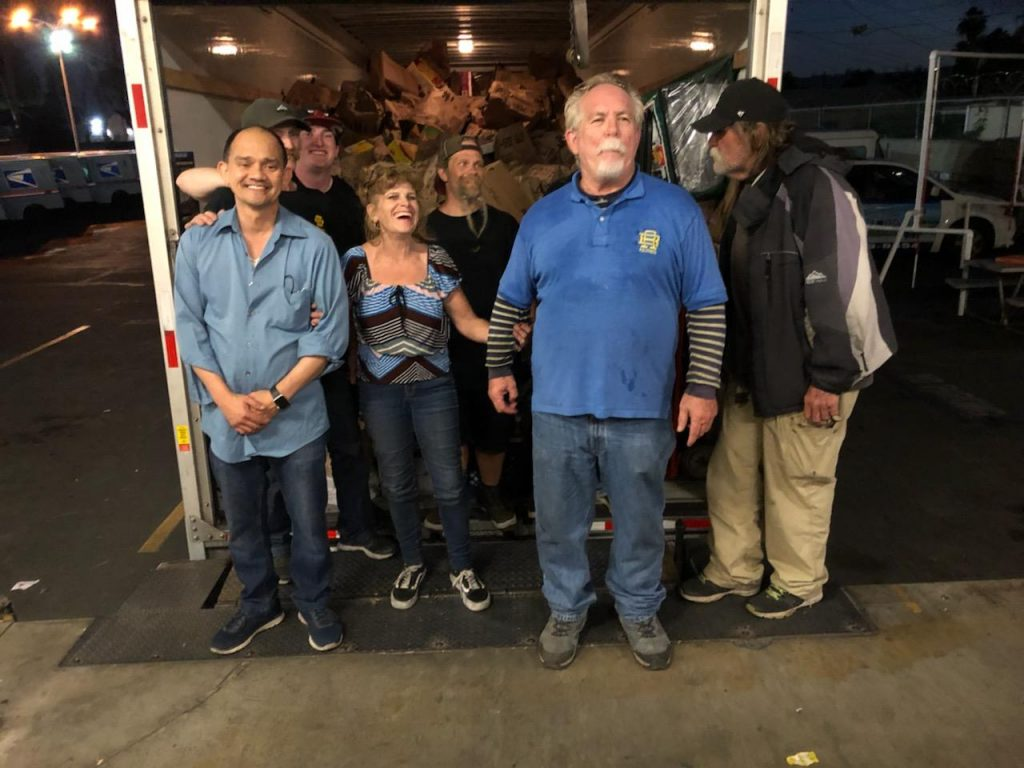 Stamp Out Hunger at post office loading U-Haul 2019