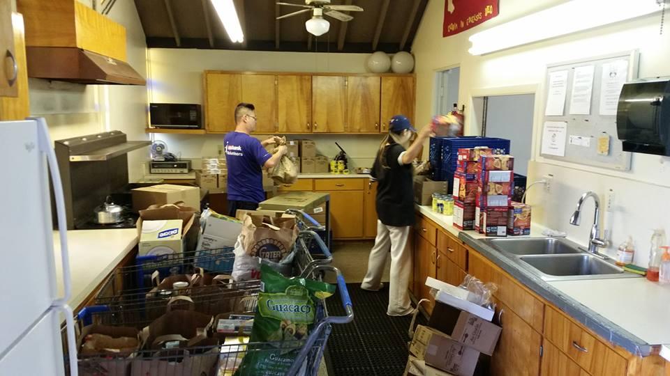 Jae and Terri sorting food