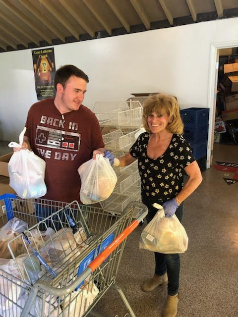 Tyler and Cathy packing easter baskets 2019